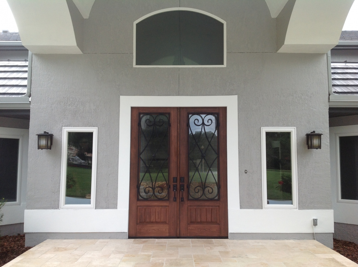 Are Your Doors Warped Old and Ugly? Is Your Air Conditioner Working Overtime? & Doors - Creative Remodeling of Orlando Contractor